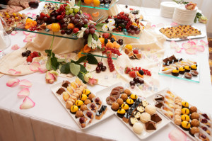 Banquet table full of sweets, fruits and berries